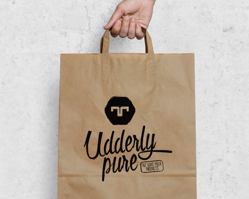 Udderly_Pure_Logo_Mockup_Banner_Bag